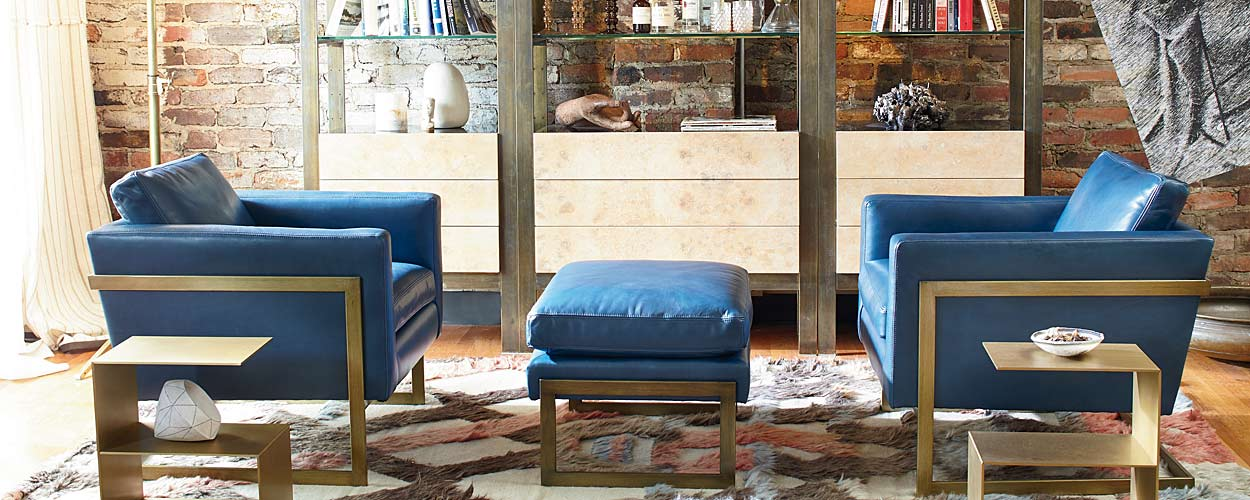 Photo of furniture in a room. Blue upholstered chairs.